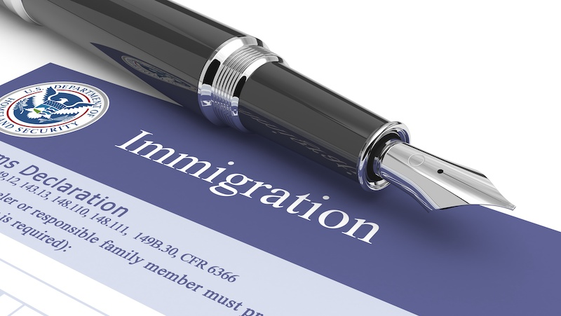 Immigration document with fountain pen