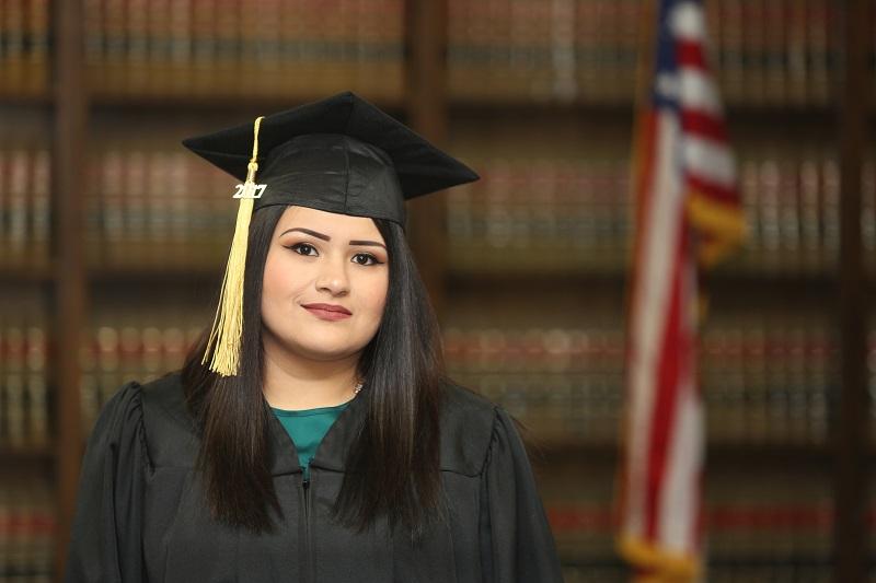 Graduation portrait of Mexican American college graduate