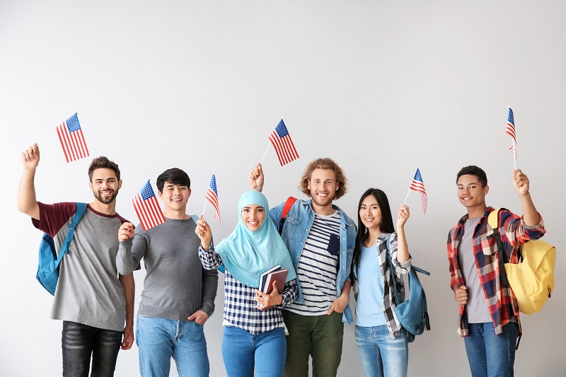 Group of international students with USA flags